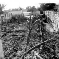 Remains of Harold an Leona Kerber's barn after fire on August 25, 1964.