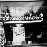 Rita Rojina with her WWII  photo display in Pauly's store front window - 1945