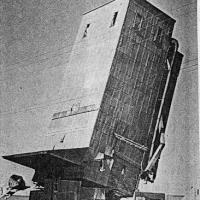 The toppling of the Chanhassen grain elevator - circa unknown