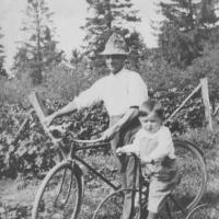L.G. Lawson and son, Charles  with bicycle and tricycle - 1918